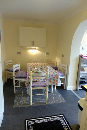 Dining room with cream, grey and purple