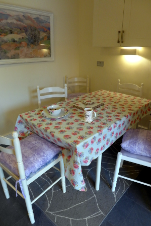 Dining room with pretty tablecloth and china