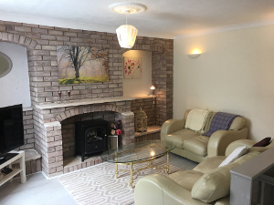 Sitting Room with 'limewash' brick fireplace