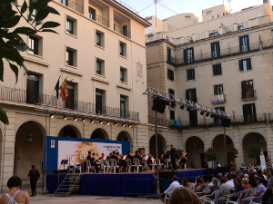 Brass concert with town hall buildings