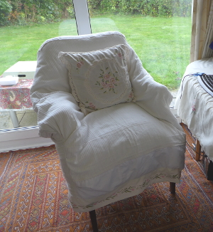 Cream chair with flower border and cushion
