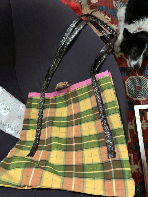 Plaid bag with floral brooch