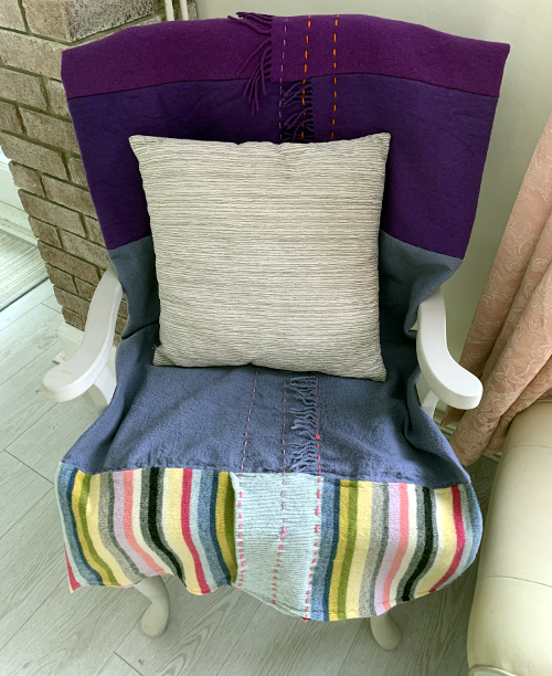 Upcycled wool rainbow throw by Amanda Howse