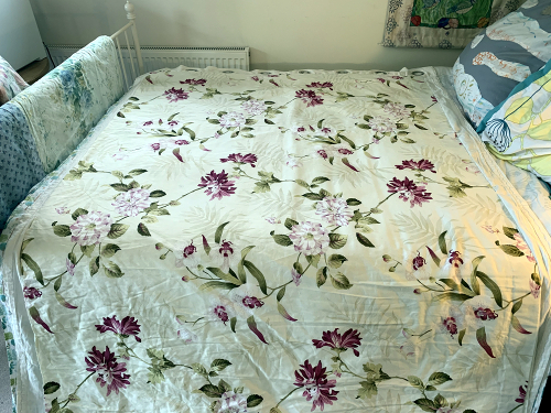 Using bed to layout fabric while painting Garden Studio