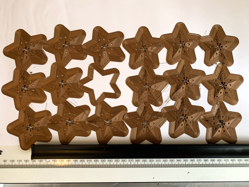 sheet of gold PLA filament 3D printed stars