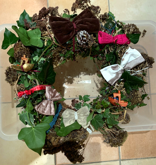 Festive wreath with pink bows ready to deliver