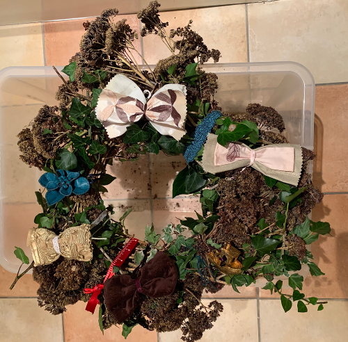 Festive teal and gol bow wreath ready to deliver